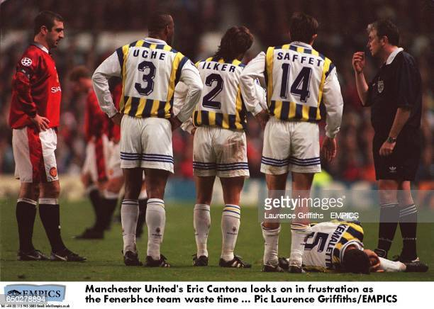 Manchester United's Eric Cantona looks on in frustration as the Fenerbahce team waste time