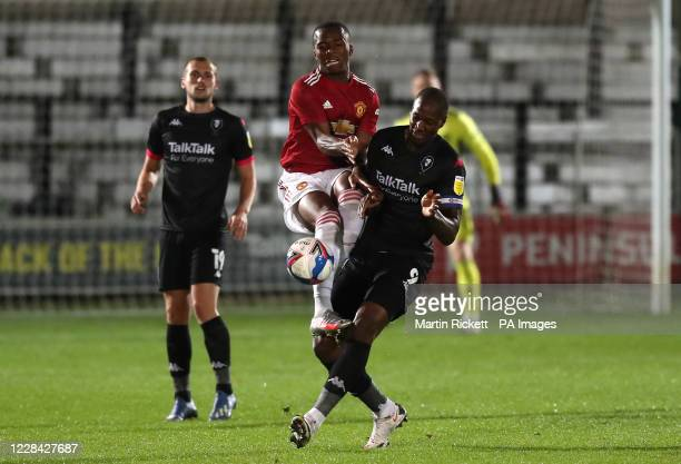 Manchester United's Ethan Laird and Salford City's Tom Elliott battle for the ball during the EFL Trophy Northern Group B match at the Peninsula...