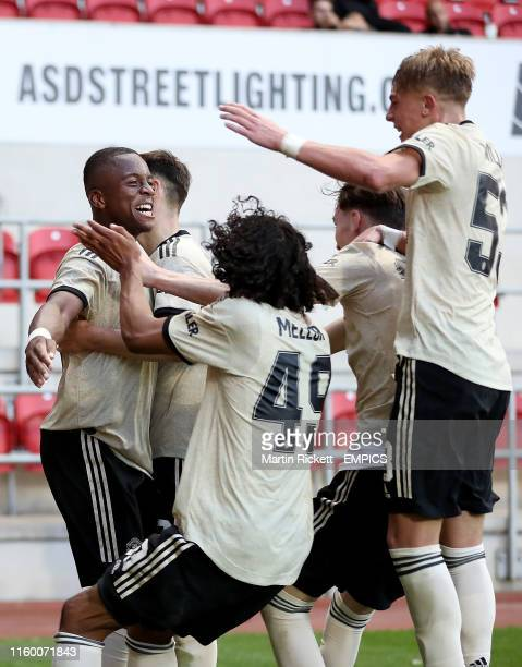 Manchester United's Ethan Laird celebrates scoring his side's first goal of the game with teammates Rotherham United v Manchester United U21 EFL...