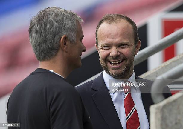 Manchester United's executive vicechairman Ed Woodward reacts as he talks with Manchester United's Portuguese manager Jose Mourinho folowing the...