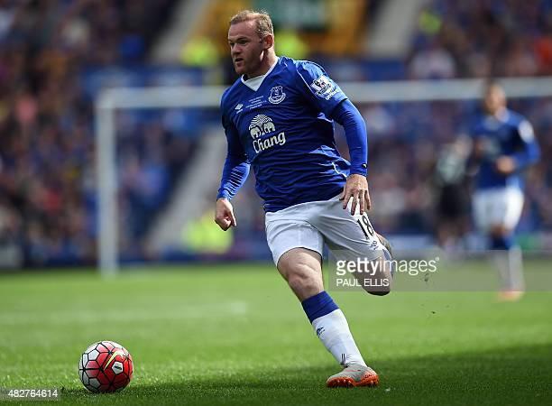 Manchester United's former Everton forward Wayne Rooney runs with the ball during the Duncan Ferguson Testimonal preseason friendly football match...
