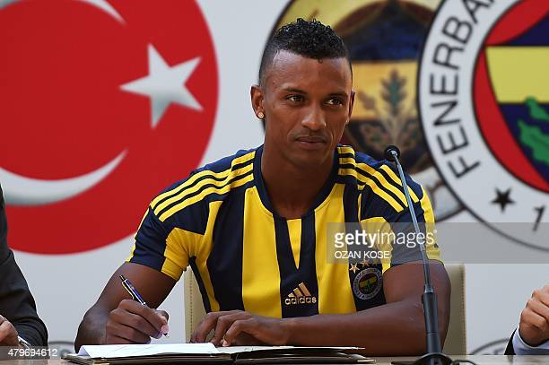 Manchester Uniteds former midfielder Portuguese Luis Nani signs a new contract next to Fenerbahce's Italian Sports Director Giuliano Terraneo during...