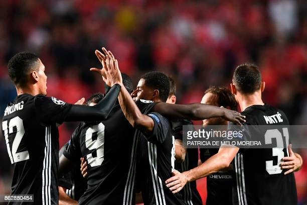 Manchester United's forward Marcus Rashford celebrates a goal during the UEFA Champions League group A football match SL Benfica vs Manchester United...
