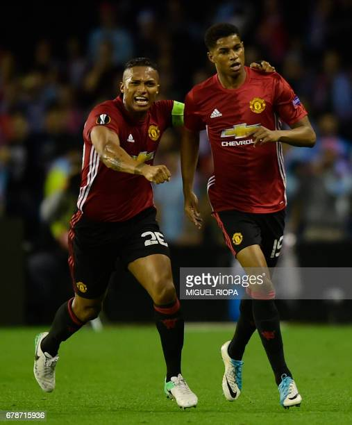 Manchester United's forward Marcus Rashford celebrates with teammate Ecuadorian defender Antonio Valencia after scoring their opener during their...