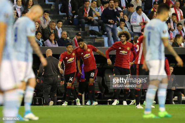 Manchester United's forward Marcus Rashford celebrates with teammates after scoring during their UEFA Europa League semi final first leg football...