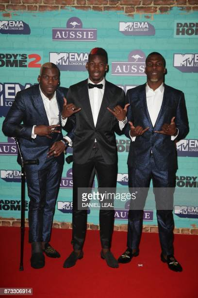 Manchester United's French footballer Paul Pogba and his brothers Guinean footballers Florentin Pogba and Mathias Pogba pose on the red carpet...