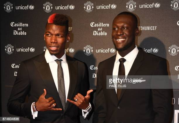 Manchester United's French midfielder Paul Pogba and British grime and hip hop artist Stormzy pose on the red carpet as they arrive to attend the...