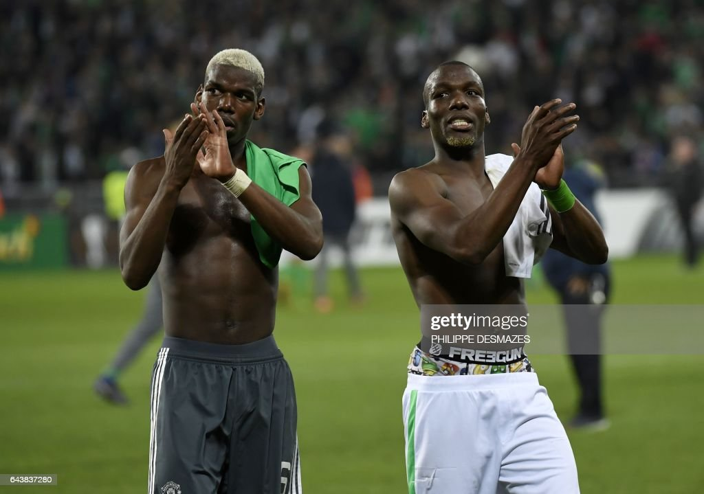 Manchester United's French midfielder Paul Pogba (L) and his brother Saint-Etienne's Guinean defender Florentin Pogba (R) greet supporters at the end of the UEFA Europa League football match between AS Saint-Etienne and Manchester United on February 22, 2017, at the Geoffroy Guichard stadium in Saint-Etienne, central France. / AFP / PHILIPPE