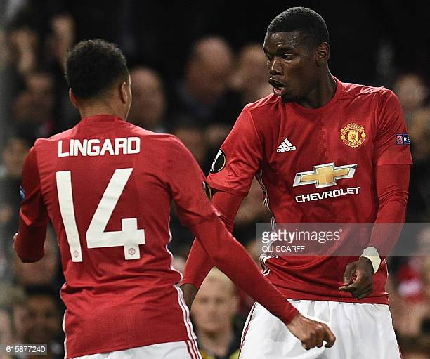TOPSHOT Manchester United's French midfielder Paul Pogba and Manchester United's English midfielder Jesse Lingard do a celebration dance after Pogba...
