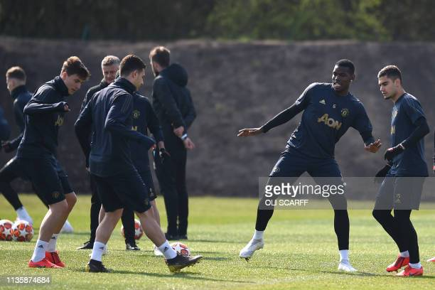 Manchester United's French midfielder Paul Pogba and teammates attend a training session at the Carrington training ground in greater Manchester...