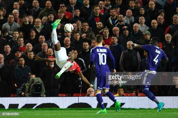 Manchester United's French midfielder Paul Pogba attempts a bicycle kick during the UEFA Europa League quarterfinal second leg football match between...