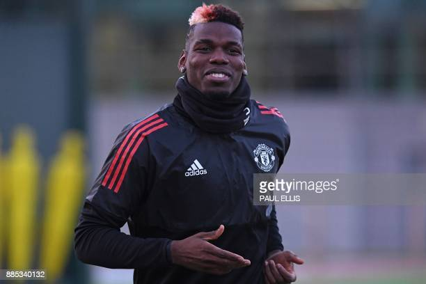 Manchester United's French midfielder Paul Pogba attends a team training session at the club's training complex near Carrington west of Manchester in...