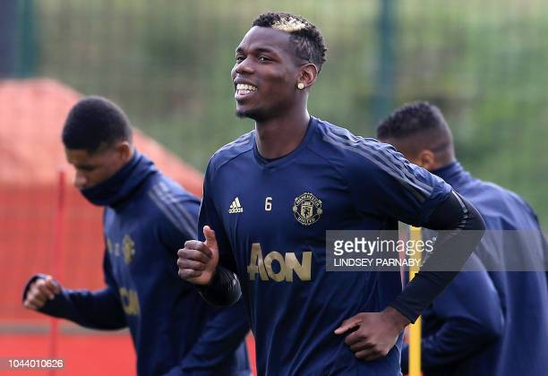 Manchester United's French midfielder Paul Pogba attends a training session at the Carrington Training complex in Manchester north west England on...