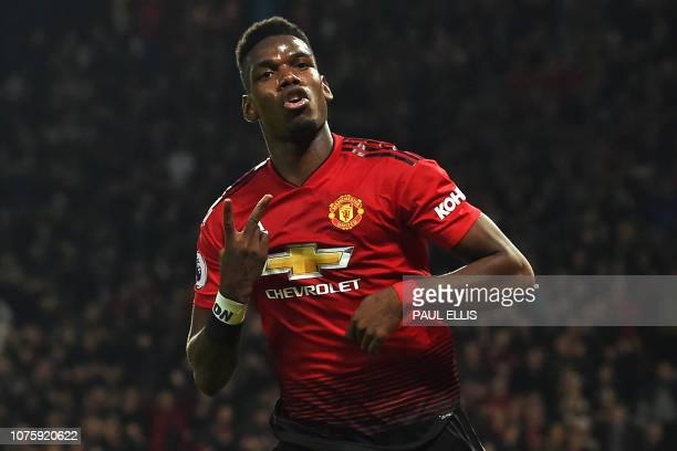 TOPSHOT Manchester United's French midfielder Paul Pogba celebrates after scoring his and their second goal during the English Premier League...