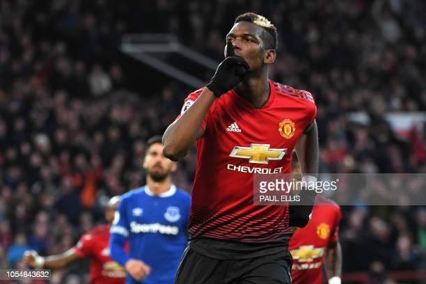 Manchester United's French midfielder Paul Pogba celebrates after scoring the opening goal of the English Premier League football match between...
