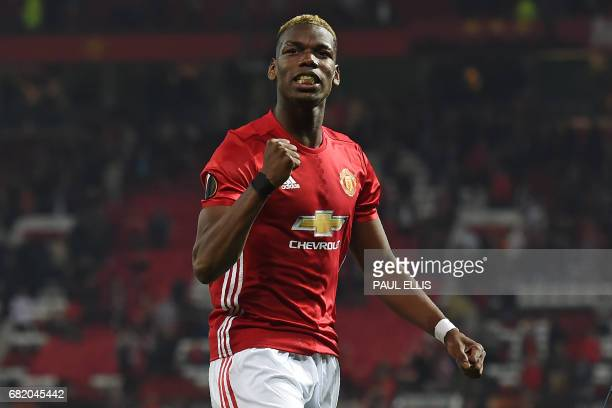 Manchester United's French midfielder Paul Pogba celebrates after the UEFA Europa League semifinal secondleg football match between Manchester United...