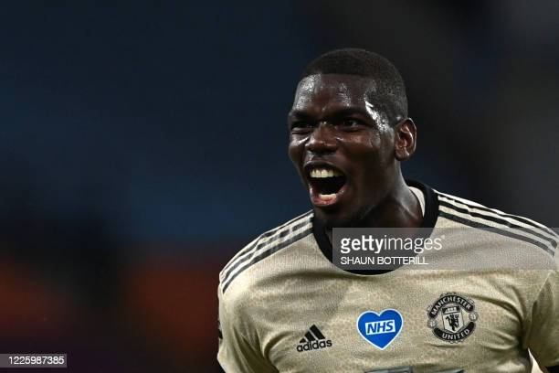 Manchester United's French midfielder Paul Pogba celebrates scoring his team's third goal during the English Premier League football match between...