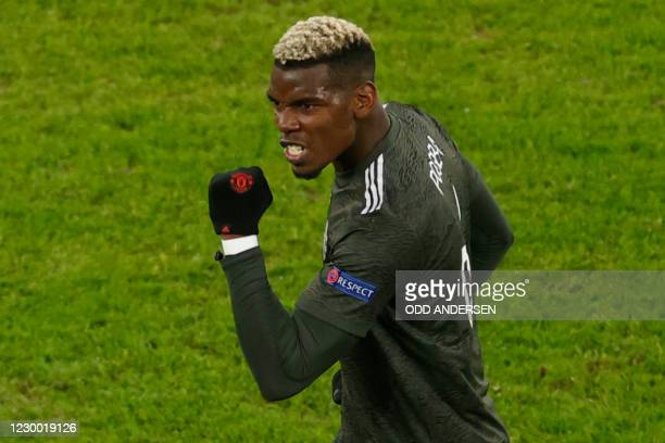 Manchester United's French midfielder Paul Pogba celebrates scoring the 3-2 goal during the UEFA Champions League Group H football match RB Leipzig v...