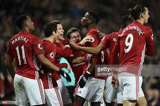 Manchester United's French midfielder Paul Pogba celebrates scoring his team's second goal during the English Premier League football match between...