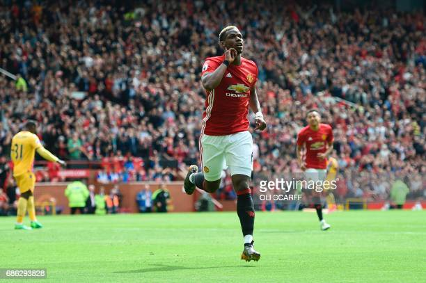 Manchester United's French midfielder Paul Pogba celebrates scoring their second goal during the English Premier League football match between...