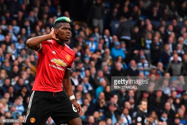 TOPSHOT Manchester United's French midfielder Paul Pogba celebrates scoring their second goal to equalise 22 during the English Premier League...
