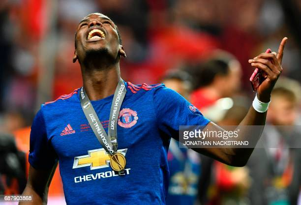 TOPSHOT Manchester United's French midfielder Paul Pogba celebrates with his medal after the UEFA Europa League final football match Ajax Amsterdam v...
