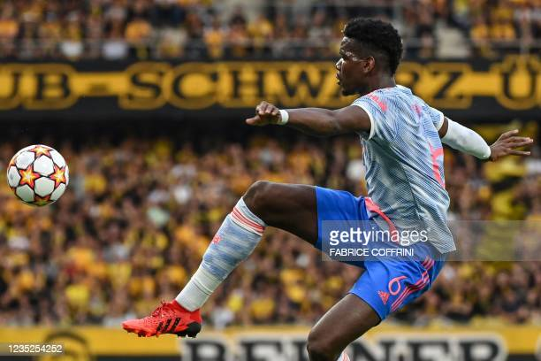 Manchester United's French midfielder Paul Pogba controls the ball during the UEFA Champions League Group F football match between Young Boys and...