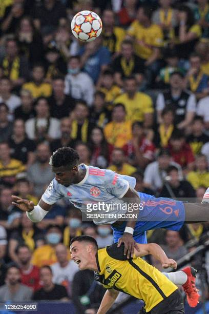 Manchester United's French midfielder Paul Pogba fights for the ball with Young Boys' Swiss midfielder Vincent Sierro during the UEFA Champions...