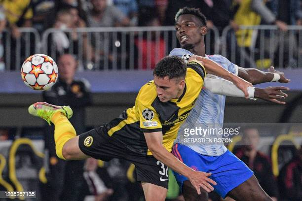 Manchester United's French midfielder Paul Pogba fights for the ball with Young Boys' Swiss midfielder Sandro Lauper during the UEFA Champions League...