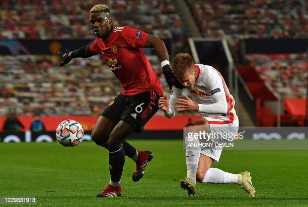 Manchester United's French midfielder Paul Pogba fouls RB Leipzig's Spanish midfielder Dani Olmo during the UEFA Champions league group H football...