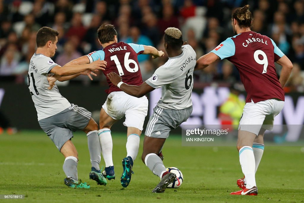 Manchester United's French midfielder Paul Pogba (2R) fouls West Ham United's English midfielder Mark Noble (2L), leading to a yellow card for Pogba, during the English Premier League football match between West Ham United and Manchester United at The London Stadium, in east London on May 10, 2018. (Photo by Ian KINGTON / AFP) / RESTRICTED TO EDITORIAL USE. No use with unauthorized audio, video, data, fixture lists, club/league logos or 'live' services. Online in-match use limited to 75 images, no video emulation. No use in betting, games or single club/league/player publications. /