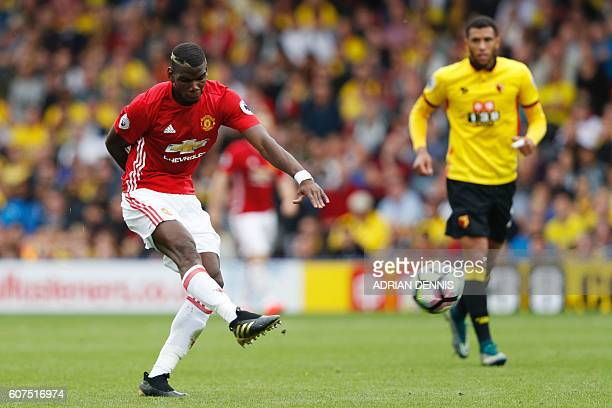 Manchester United's French midfielder Paul Pogba has a shot on goal during the English Premier League football match between Watford and Manchester...