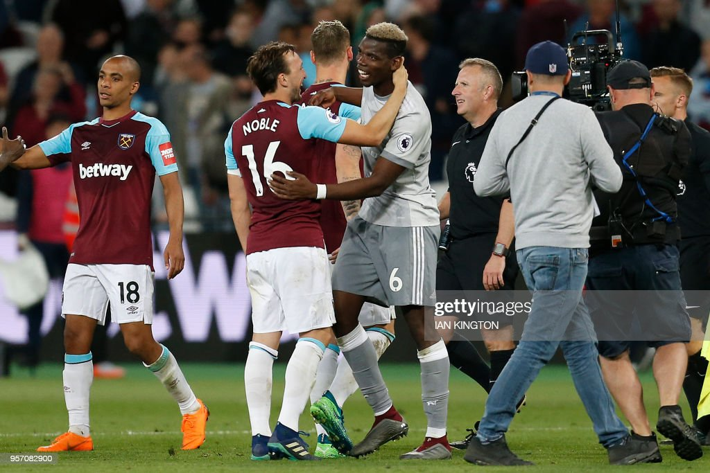 Manchester United's French midfielder Paul Pogba (centre R) hugs West Ham United's English midfielder Mark Noble following the English Premier League football match between West Ham United and Manchester United at The London Stadium, in east London on May 10, 2018. (Photo by Ian KINGTON / AFP) / RESTRICTED TO EDITORIAL USE. No use with unauthorized audio, video, data, fixture lists, club/league logos or 'live' services. Online in-match use limited to 75 images, no video emulation. No use in betting, games or single club/league/player publications. /