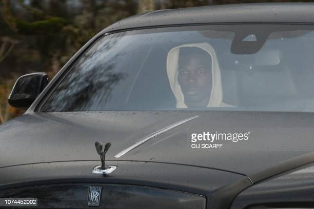 Manchester United's French midfielder Paul Pogba in a Rolls Royce car leaves the club's Carrington Training complex in Manchester north west England...