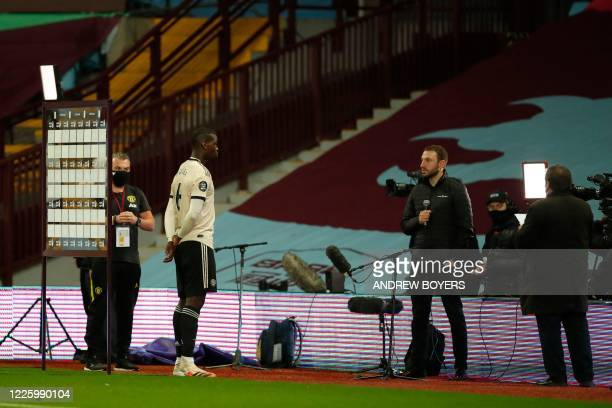 Manchester United's French midfielder Paul Pogba is interviwed by a TV crew during the English Premier League football match between Aston Villa and...