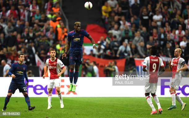 Manchester United's French midfielder Paul Pogba jumps during the UEFA Europa League final football match Ajax Amsterdam v Manchester United on May...