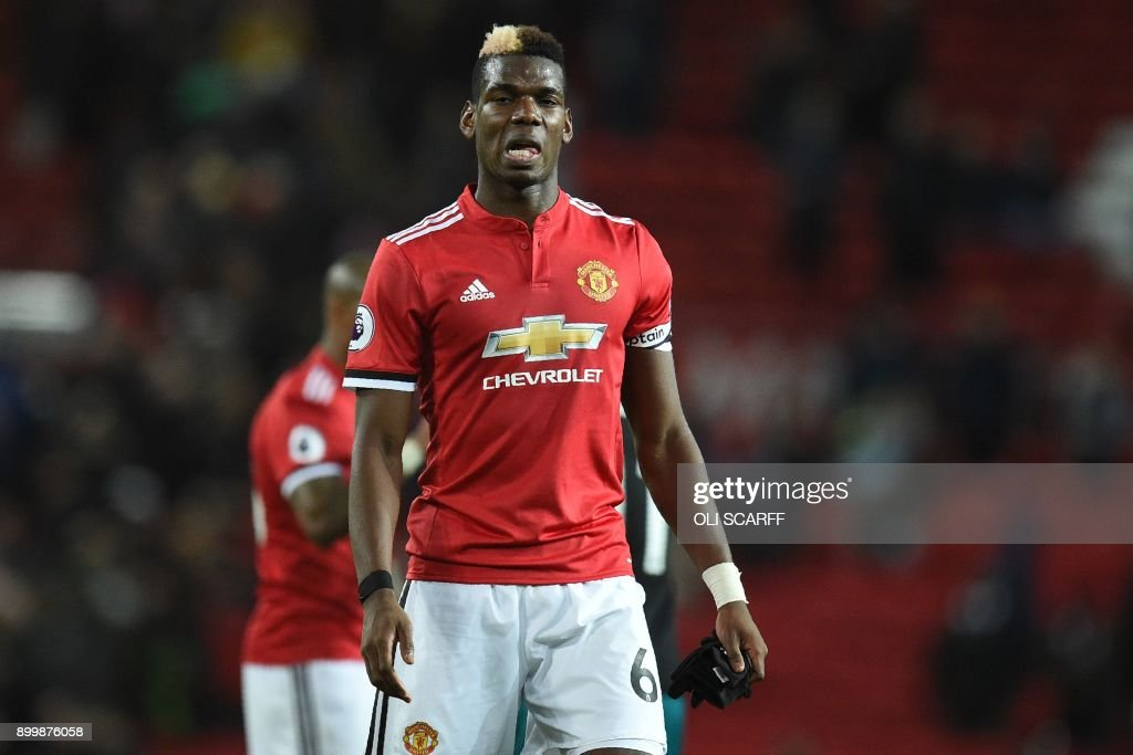 Manchester United's French midfielder Paul Pogba leaves after the English Premier League football match between Manchester United and Southampton at Old Trafford in Manchester, north west England, on December 30, 2017. / AFP PHOTO / Oli SCARFF / RESTRICTED TO EDITORIAL USE. No use with unauthorized audio, video, data, fixture lists, club/league logos or 'live' services. Online in-match use limited to 75 images, no video emulation. No use in betting, games or single club/league/player publications. /