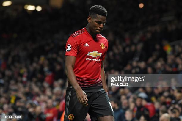 TOPSHOT Manchester United's French midfielder Paul Pogba leaves the pitch after being shown a red card during the first leg of the UEFA Champions...
