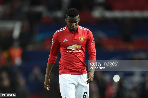 TOPSHOT Manchester United's French midfielder Paul Pogba leaves the pitch after losing a last 16 second leg UEFA Champions League football match...