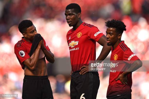 Manchester United's French midfielder Paul Pogba Manchester United's English midfielder Jesse Lingard and Manchester United's English midfielder...