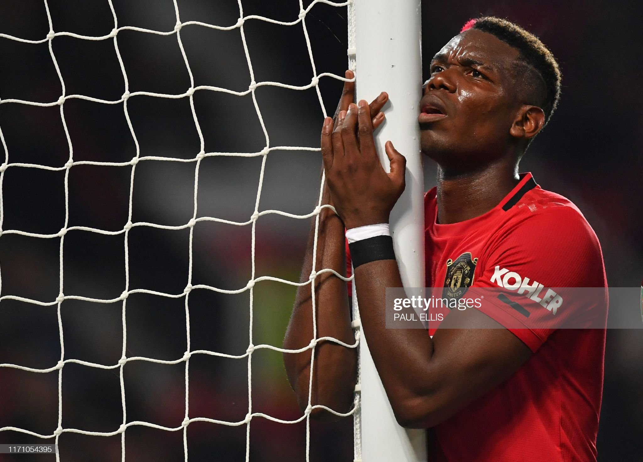 https://media.gettyimages.com/photos/manchester-uniteds-french-midfielder-paul-pogba-reacts-after-missing-picture-id1171054395?s=2048x2048