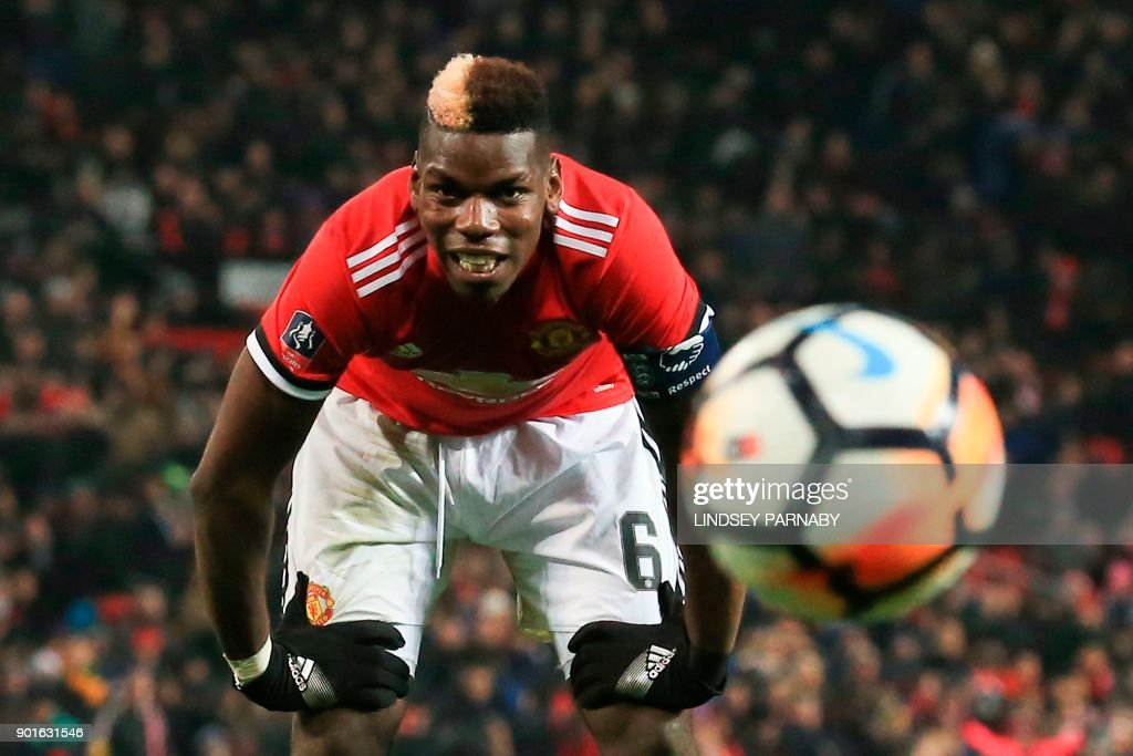 TOPSHOT - Manchester United's French midfielder Paul Pogba reacts after missing a chance during the English FA Cup third round football match between Manchester United and Derby County at Old Trafford in Manchester, north west England, on January 5, 2018. / AFP PHOTO / Lindsey PARNABY / RESTRICTED TO EDITORIAL USE. No use with unauthorized audio, video, data, fixture lists, club/league logos or 'live' services. Online in-match use limited to 75 images, no video emulation. No use in betting, games or single club/league/player publications. /