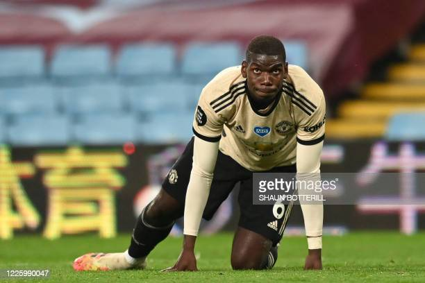 Manchester United's French midfielder Paul Pogba reacts after the English Premier League football match between Aston Villa and Manchester United at...