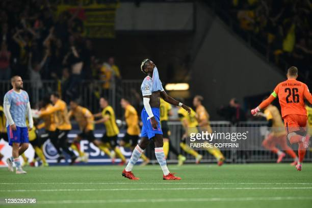 Manchester United's French midfielder Paul Pogba reacts after Young Boys' US forward Jordy Siebatcheu Pefok scored a goal during the UEFA Champions...
