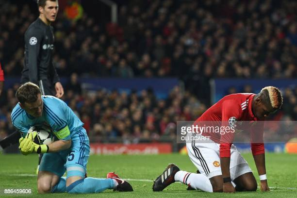 Manchester United's French midfielder Paul Pogba reacts as CSKA Moscow's Russian goalkeeper Igor Akinfeev gathers the ball during the UEFA Champions...