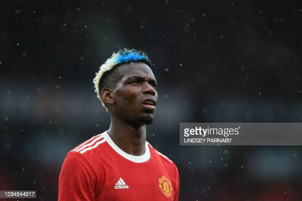 Manchester United's French midfielder Paul Pogba reacts at the final whistle of the pre-season friendly football match between Manchester United and...