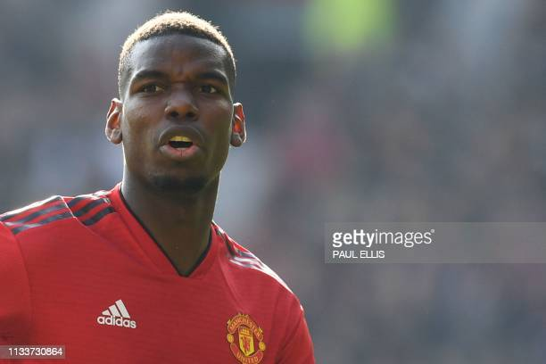 Manchester United's French midfielder Paul Pogba reacts during the English Premier League football match between Manchester United and Watford at Old...