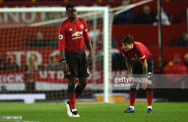 TOPSHOT Manchester United's French midfielder Paul Pogba reacts during the English Premier League football match between Manchester United and...