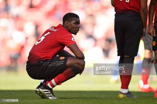 Manchester United's French midfielder Paul Pogba reacts to their defeat on the pitch after the English Premier League football match between...