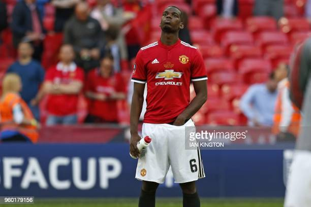 Manchester United's French midfielder Paul Pogba reacts to their defeat on the pitch after the English FA Cup final football match between Chelsea...
